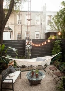string lights and hammock in a tiny yard